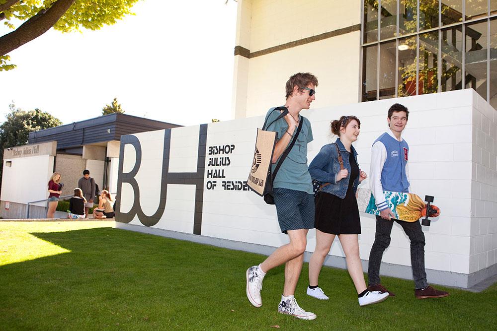 Bishop julius hall outside students walking skateboard landscape