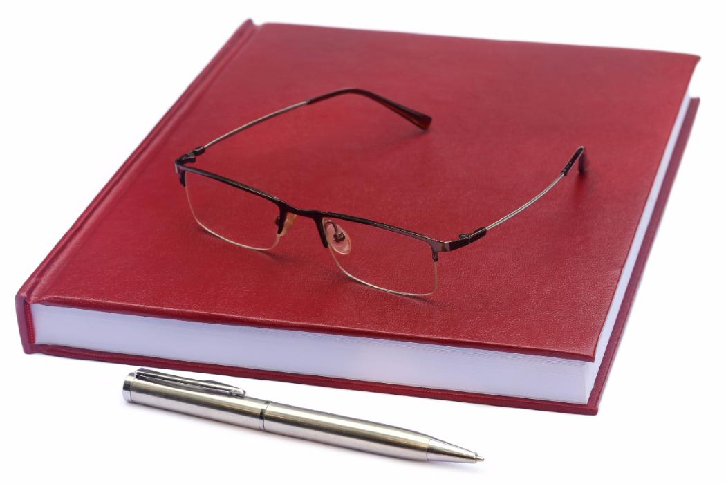 Maroon coloured thesis with glasses