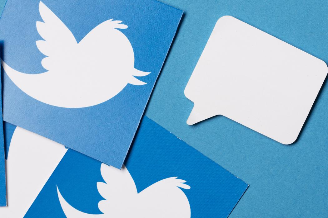 twitter logo with speech bubble