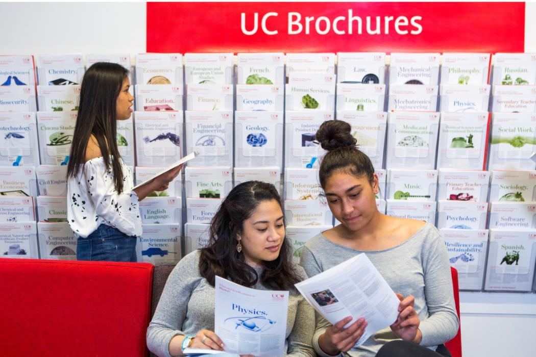 pacific students examining subject brochures