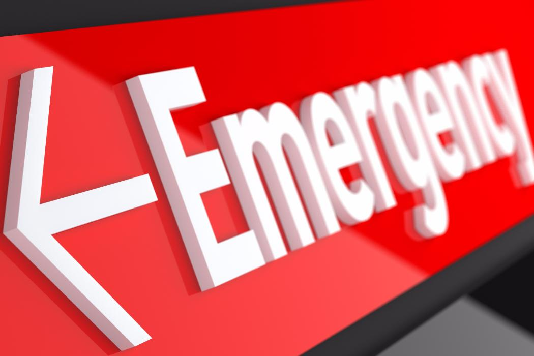 red sign with white emergency lettering