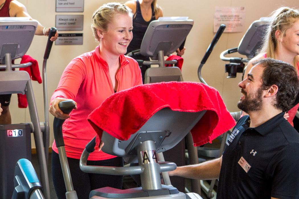 Cross trainer user with Instructor at UC Rec Centre