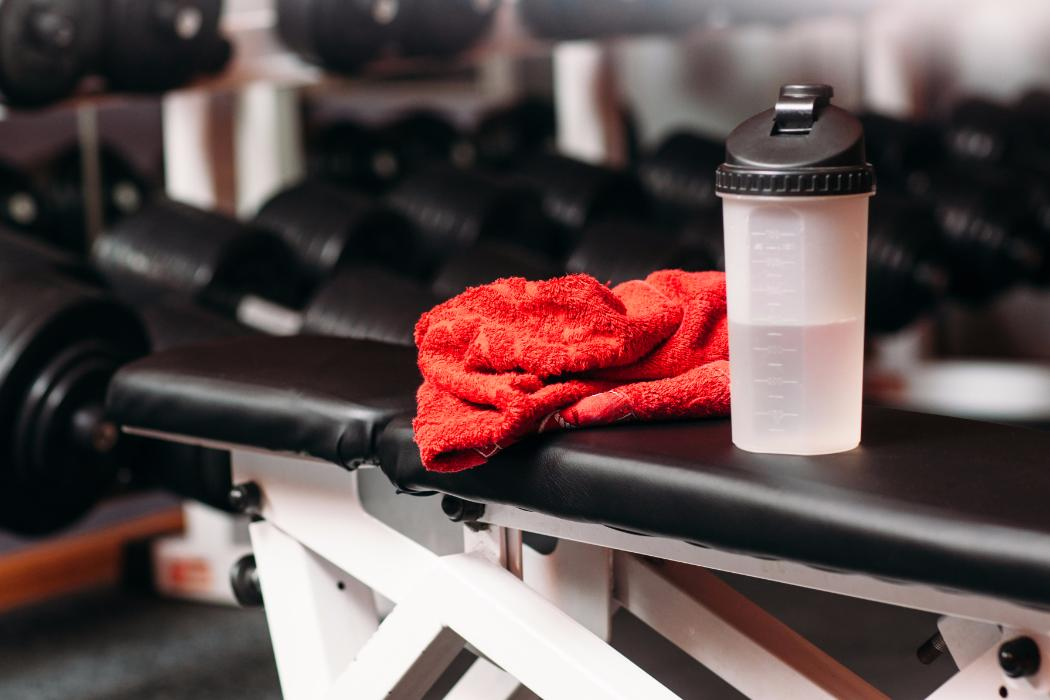 Gym towel and bottle on bench