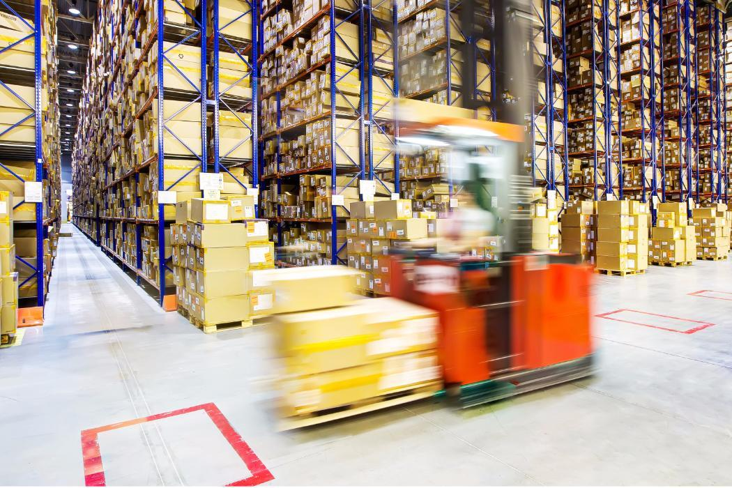 Forklift moving fast in a warehouse